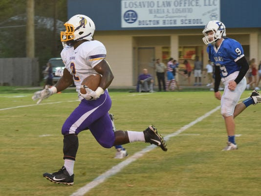 """ANI ASH vs. Bolton ASH's Xstavius """"XT"""" Dorty (2, left) breaks away from Bolton defenders including Zach Roberts (9, right) to score a touchdown Friday Sept. 11, 2015.-Melinda Martinez/The Town Talk"""
