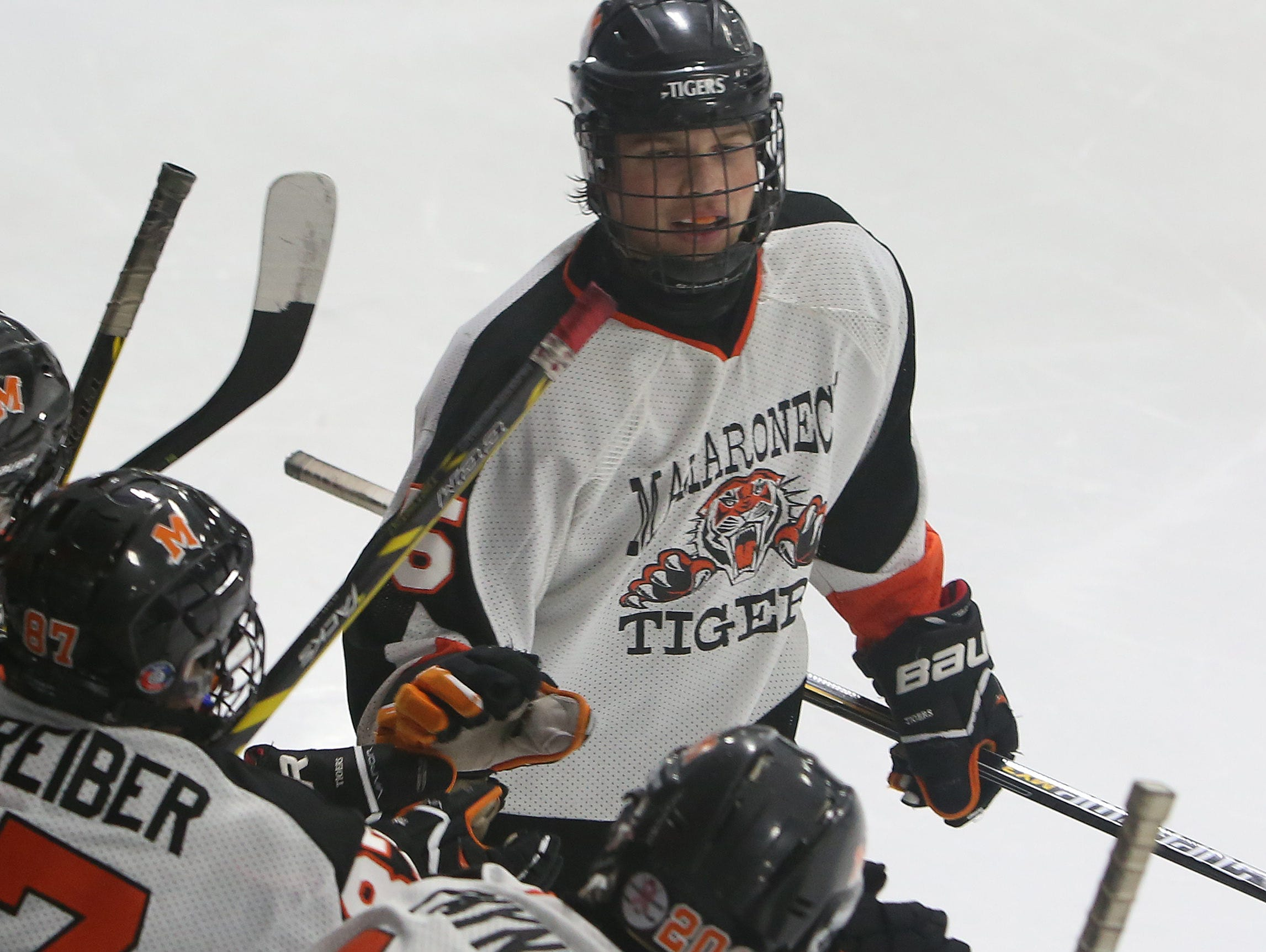 Mamaroneck's Jake Levine (5) celebrates with teammates after his third period goal against Clarkstown during hockey action at Hommocks Park Ice Rink in Mamaroneck Dec. 22, 2015. Mamaroneck won the game 3-0.