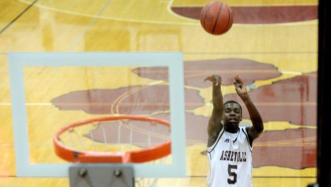 Asheville High's Jalann McPhail shoots a free throw on Friday.