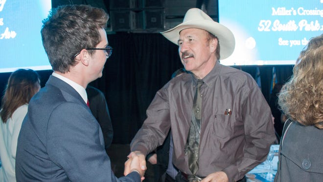 In this March 18, 2017, file photo, congressional candidate Rob Quist meets with supporters during the annual Mansfield Metcalf Celebration dinner hosted by the state's Democratic Party in Helena, Mont.