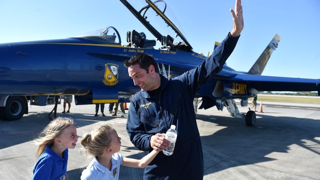 """Did you see the airplane when it was going up like this,"" said TCPalm editor Adam Neal, describing the takeoff to his twin daughters, Kaley (left) and Ryley, 6, after taking a media flight in a Blue Angels F/A-18 Hornet aircraft Wednesday, April, 18, 2018, at the Vero Beach Regional Airport in Vero Beach. The Blue Angels will be performing during the annual Vero Beach Air Show this weekend, Saturday, April 21, and Sunday April 22, at the Vero Beach Regional Airport."