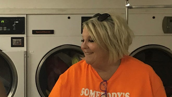 Candis Hicks, right, visits during the Laundry Love event at sponsored by the Somebody's Rusty Mission of First United Methodist Church in San Angelo.
