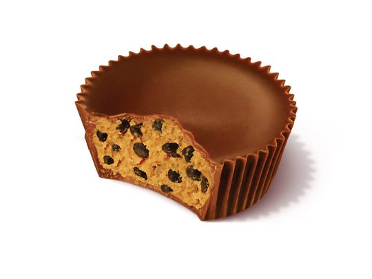 Hershey's new Reese's Crunchy Cookie Cup has crunchy bits of chocolate inside.