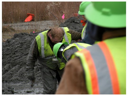 Wearing ordinary gear, workers were covered from head to toe in wet coal ash for 14-hour days, in some cases for years.