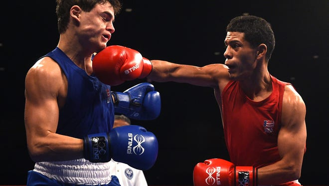 Antonio Vargas, right, hits Christian Carto during their 114 pounds  challengers bracket bout at the U.S. Olympic Team Trials in the Reno Events Center on Dec. 11, 2015. Vargas won the fight by TKO.
