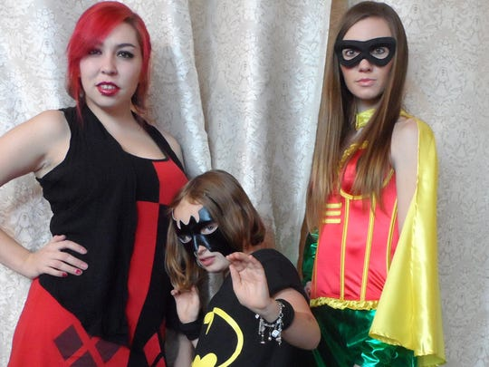 The crew at PolyEsther's Costume Boutique in Midtown Reno shows off some last-minute costumes for Comic Con. They are, from left, Tara Davis, Willa Dunaway and Jessie Stipech.