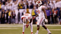 Dejected Wisconsin Badgers Derrick Tindal (left) and