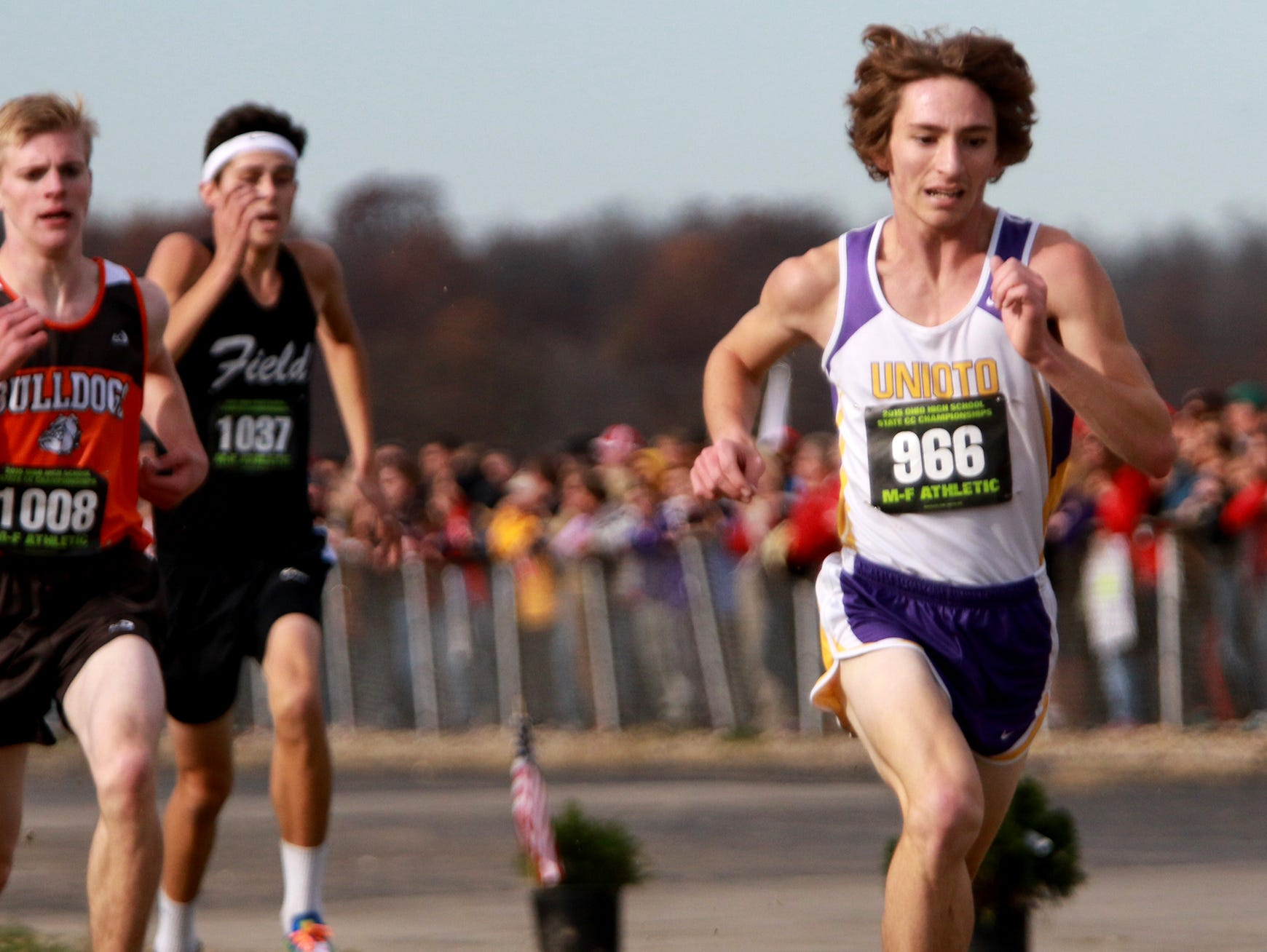 David Magda from Unioto sprints to the finish line at the state cross country meet.