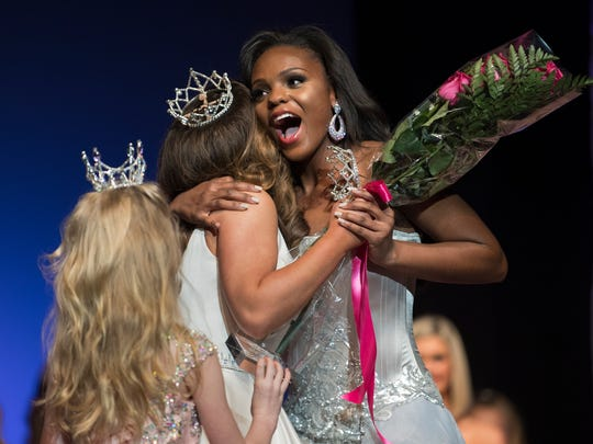 Miss Tennessee Soybean Festival Princess Nadia Treadwell is congratulated by 2017 Miss Iris Tennessee Teen Peyton Jones Friday, March 9, 2018, after winning the 2018 Miss Iris Tennessee Teen pageant at the Carl Perkins Civic Center in Jackson.