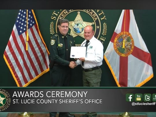 St. Lucie County Sheriff Ken Mascararecognized Pauley,a member of St. Lucie County's Environmental Resources Department, with a lifesaving award at the Sheriff's quarterly awards ceremony.