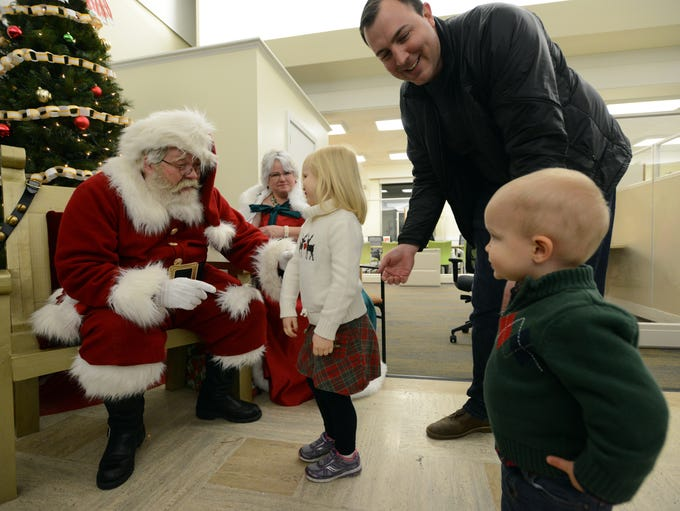Elaine Haire, 4, walks up to Tim and Ginny Etienne