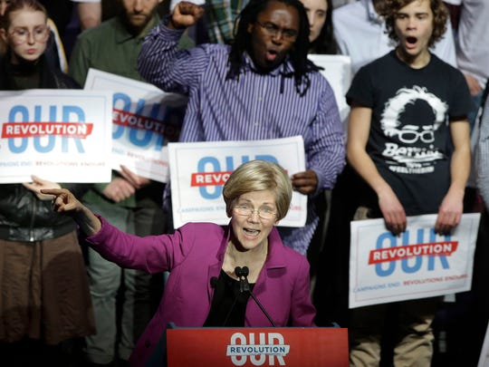 Sen. Elizabeth Warren, D-Mass., speaks during a rally Friday, March 31, 2017, in Boston. Sen. Bernie Sanders, I-Vt., and Warren made a joint appearance at the evening rally in Boston as liberals continue to mobilize against the agenda of Republican President Donald Trump. (AP Photo/Steven Senne)