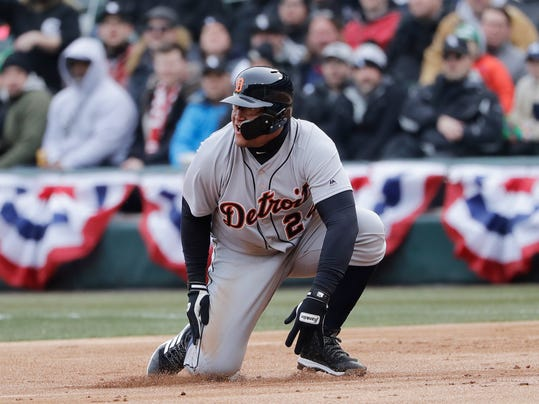 Detroit Tigers' Miguel Cabrera falls down as he reaches first base after hitting a single during the first inning against the Chicago White Sox in a baseball game Thursday, April 5, 2018, in Chicago. The Tigers won 9-7. (AP Photo/Nam Y. Huh)