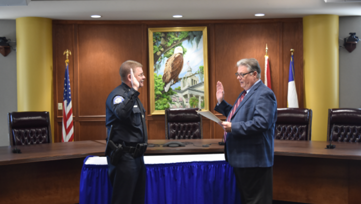 Greg Gibson (left) sworn in as police chief by TCC President Jim Murdaugh.