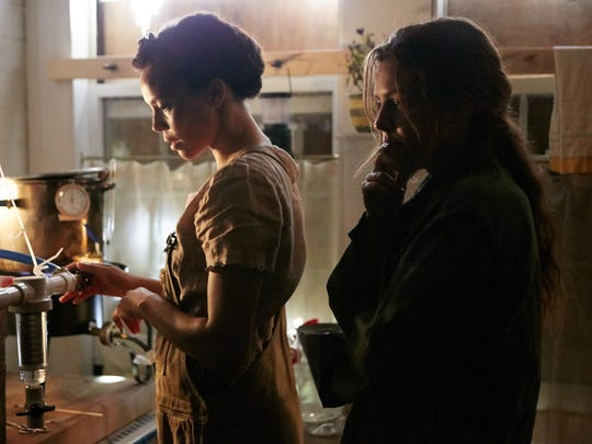 """Carmen Ejogo (left) and Riley Keough star in """"It Comes"""