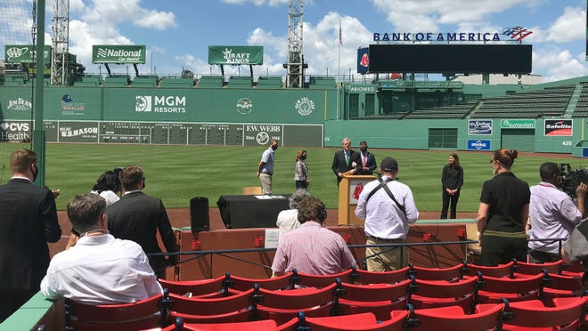Massachusetts Gov. Charlie Baker will reportedly be one of the first-throw pitchers tonight at Fenway Park. In this file photo, he is seen, at podium, speaking about Phase 3 of the state's reopening plan during a media availability at Fenway Park, Thursday, July 2, 2020, in Boston.