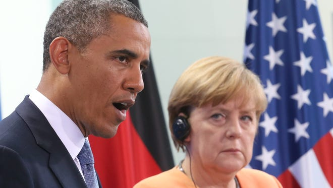 President Obama speaks  during a  news conference with German Chancellor Angela Merkel in Berlin.
