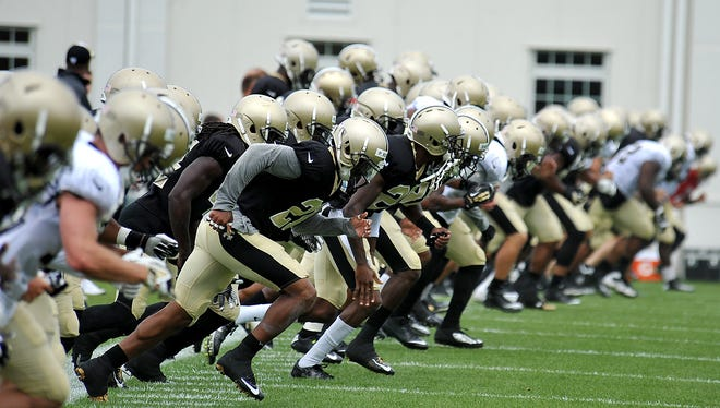 New Orleans Saints run sprints to end practice during there NFL football training camp in White Sulphur Springs, W.Va., Friday.