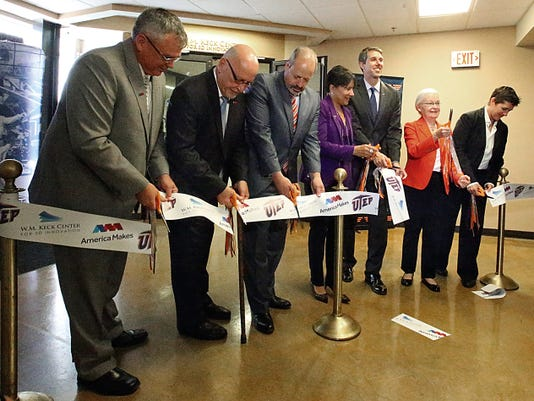 Rudy Gutierrez—El Paso Times Dignitaries, including UTEP president Diana Natalicio, second from right, and U.S. Rep. Beto O'Rourke cut the ribbon on the first satellite center of America Makes at the W.M. Keck Center for 3D Innovation Friday on the UTEP campus.