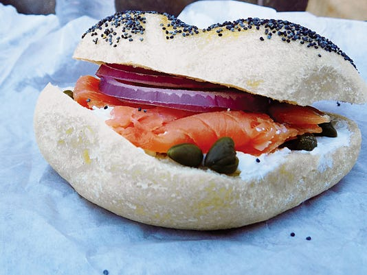 The Alaskan (9) lox on plain cream cheese with capers and onion on a poppy seed bagel.