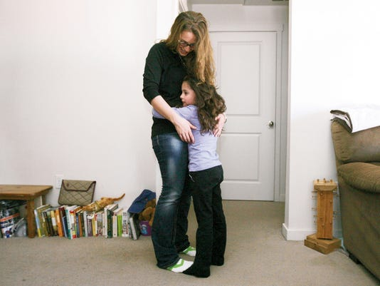 Morgan Grant spends time with her daughter, Aundrea, at her apartment. It was a chance phone call from her daughter, who was being kept from her, that led to Grant escaping her life as a sex-trafficking victim.