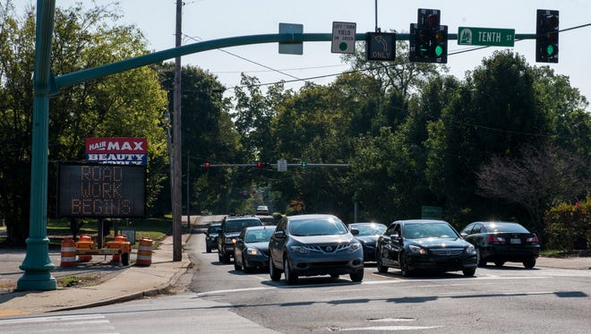 """A sign set at the corner of Madison and Tenth reads """"Road Work Begins."""" Plans to repave start this weekend."""