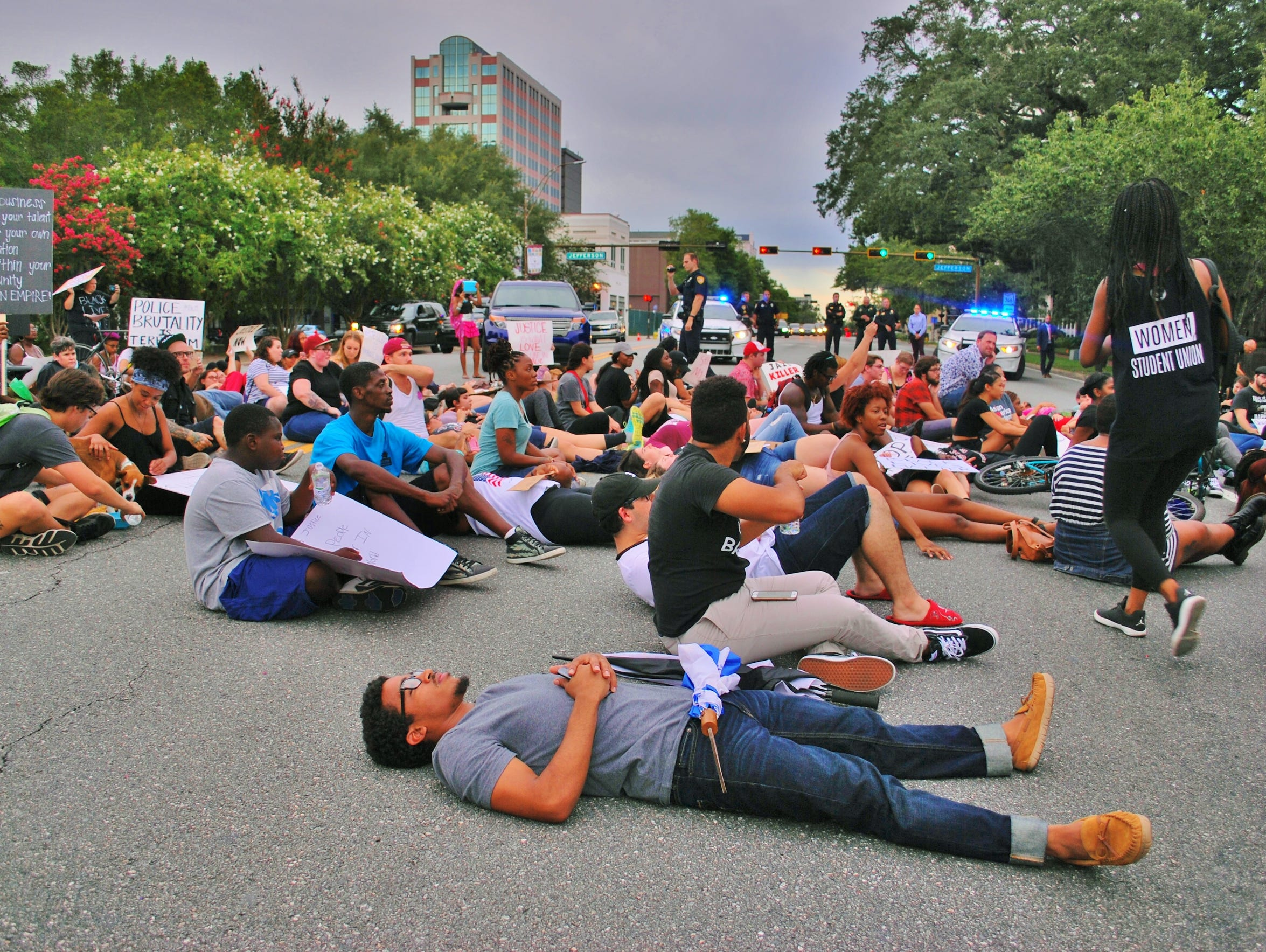 Protestors staged a die-in on Monroe Street in front