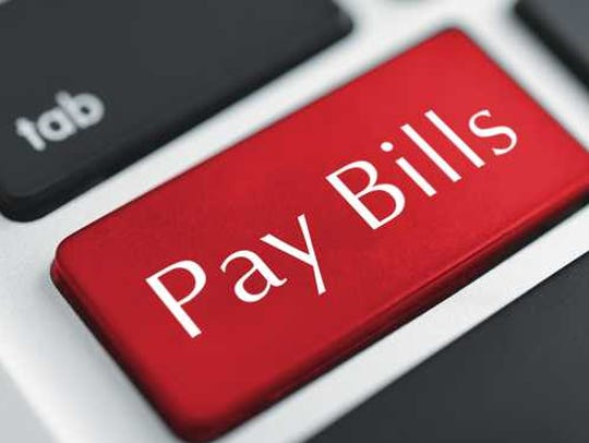 A red key on the keyboard that reads pay bills.