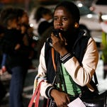 Regina Joseph of the group the Dream Defenders speaks to a crowd gathered outside the Civic Center on Monday after Darren Wilson was not indicted for charges in the shooting death of Ferguson teenager Michael Brown.