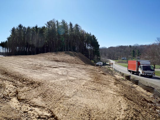 A truck passes by the new route that will be completed
