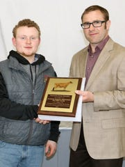 Austin Nauman, Norwalk, (left) the recipient of the Wisconsin Junior Breeder of the Year Award, is pictured with Brian Barlass, Janesville, WI, WJBA President.