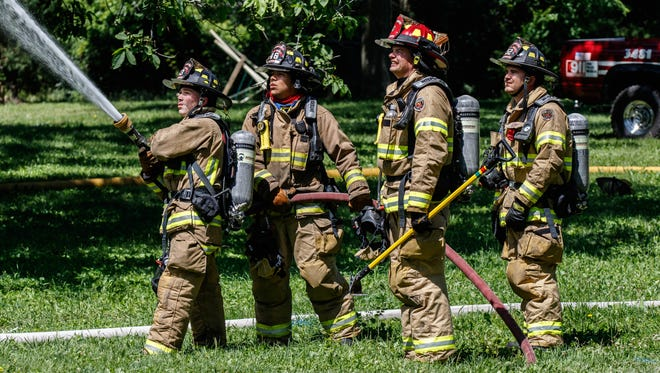 Waterford firefighters take part in a live fire training hosted by the Mukwonago Fire Department in July 2017.