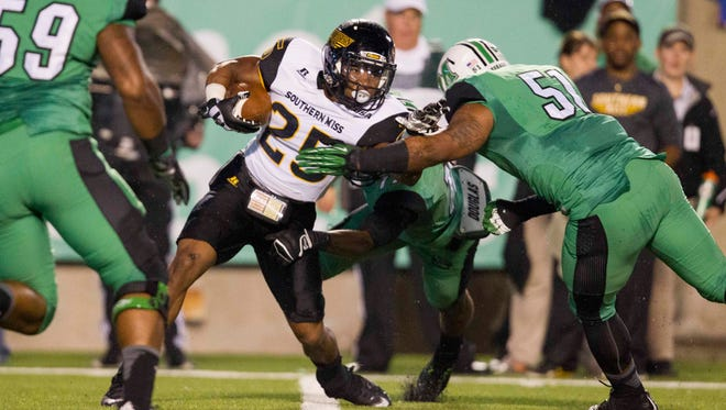 Running back Ito Smith (25) is ready to have an even bigger season for Southern Miss in 2016 after averaging 134 total yards per game last season.