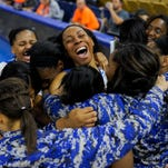 North Central players celebrate their 56-40 victory over Arcadia in a girls' basketball game in the LHSAA Top 28 at Burton Complex Coliseum in Lake Charles, La., Tuesday, March 3, 2015. North Central will compete in the LHSAA Class 1A State Championship on Saturday, March 7.