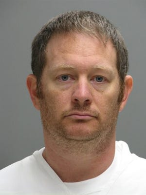 This booking photo provided by the Delaware Department of Justice shows Lee Robert Moore. Federal authorities say Moore, a Secret Service agent from Maryland, sent obscene images and texts to someone he thought was a young Delaware girl, sometimes doing it while on duty at the White House. (Delaware Department of Justice via AP) MANDATORY CREDIT