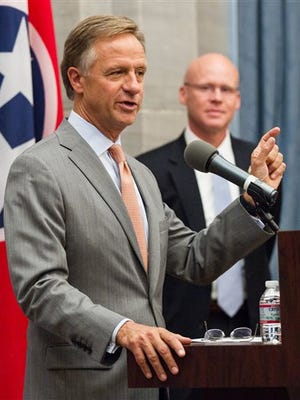 Tennessee Gov. Bill Haslam announces the retirement plans of TennCare Director Darin Gordon, right, during a press conference at the state Capitol in Nashville, Tenn., on Wednesday, March 30, 2016. Wendy Long is the new director.