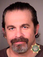 This Jan. 27, 2016, file photo, provided by the Multnomah County Sheriff's Office shows Peter Santilli, one of the members of an armed group occupying the Malheur National Wildlife Refuge as part of a dispute over public lands in the Western U.S. On the eve of trial Tuesday, Sept. 6, 2016, federal prosecutors in Portland, Ore., have dropped the federal conspiracy indictment against Santilli, a self-described independent broadcaster who was present in Harney County during the 41-day occupation of the Malheur National Wildlife Refuge. (Multnomah County Sheriff via AP, File)