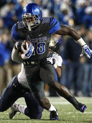 November 7, 2015 - Memphis running back Doroland Dorceus (front) scrambles past Navy defender Kikau Pescaia (back) at Liberty Bowl Memorial Stadium.