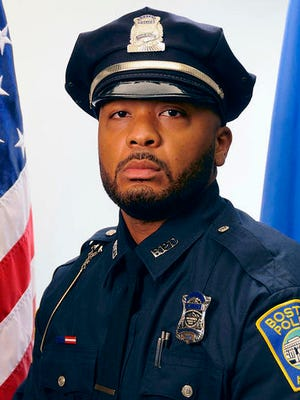 This undated official portrait released by the Boston Police Department shows policer officer Dennis Simmonds, who died on April 10, 2014. Simmonds was among the officers at the scene in Watertown, Mass., in the early hours of April 19, 2013, when the Boston Marathon bombers were engaged in a shootout with police. His death was linked to head injuries he sustained at that time when an explosive thrown by one of the Tsarnaev brothers detonated near him.