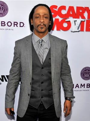 """Katt Williams, a cast member in """"Scary Movie V,"""" poses at the Los Angeles premiere of the film at the Cinerama Dome, in Los Angeles. Los Angeles prosecutors say Suge Knight and the comedian Williams were arrested and charged with one count of robbery on Wednesday after a paparazzo reported the men stole her camera in Beverly Hills on Sept. 5."""