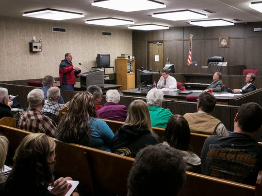 Thomas Cluff, a volunteer fire fighter, speaks to the Iron County Commissioners about why he believes they shouldn't sell the county's ambulance service to Gold Cross during a hearing on Monday, March 9, 2015.