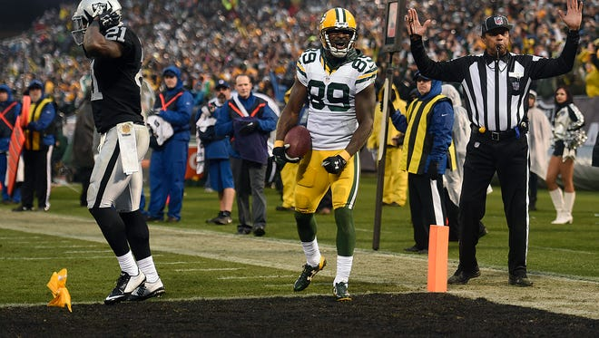 Green Bay Packers receiver James Jones (89) reacts after a penalty flag was thrown while making a catch in the end zone in the fourth quarter against the Oakland Raiders at the O.co Coliseum. Jones' touchdown catch was called off.
