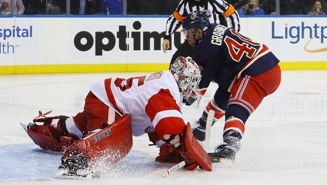 Red Wings goalie Jimmy Howard makes the second-period save on Michael Grabner of the New York Rangers at Madison Square Garden on Oct. 19, 2016 in New York City.