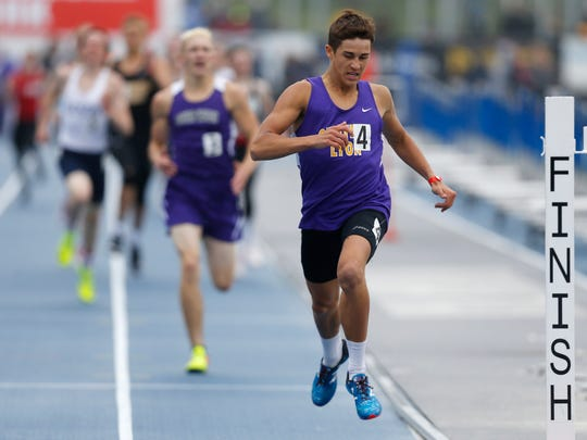 Central Lyon's Gable Sieperda crosses the finish line