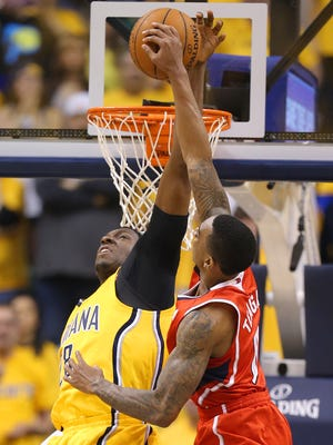 Pacers center Ian Mahinmi blocks the shot of Atlanta Hawks guard Jeff Teague during the first half of action. Indiana Pacers play the Atlanta Hawk in game 7 of the first round in the Eastern Conference playoffs Saturday, May 3, 2014, evening at Bankers Life Fieldhouse.