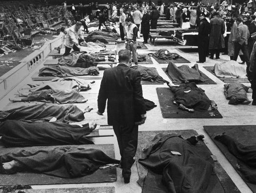 Scores of dead lie on the ice of the Indiana State Fairgrounds Coliseum following an explosion that ripped through the building during the finale of the Holiday on Ice show in Indianapolis at night on Thursday, Oct. 31, 1963. (AP Photo/Bob Daugherty)