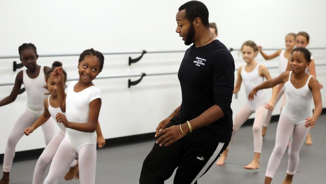 Nashville Ballet instructor H. D. Horner III works with Taylor Lynons, Areya Rice and other girls from Rejoice School of Ballet during a special day of classes at Nashville Ballet on Oct. 5.