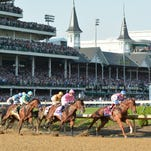 Dortmund has an early lead past the first turn of the 141st Kentucky Derby at Churchill Downs. Saturday May 1, 2015.