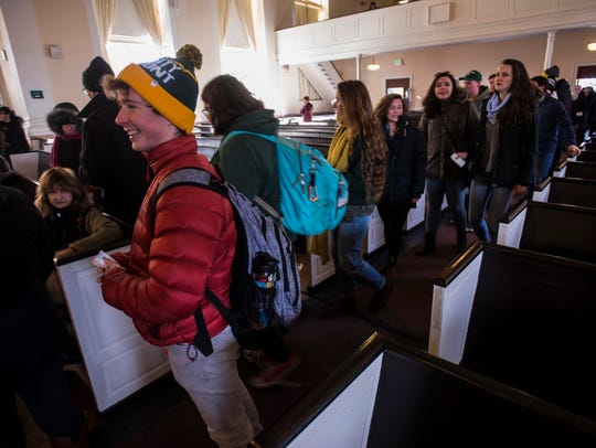 UVM students flow into Ira Allen Chapel Friday morning,