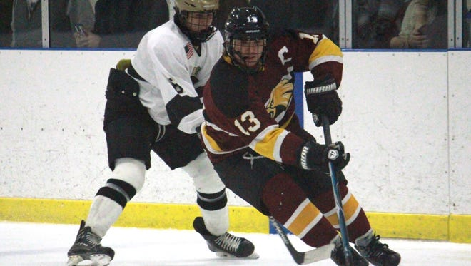 Robbie Wiatrowski (13) recorded the 100th point of his career in a 7-5 win over Wall on Friday.